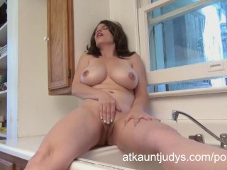 Anal Cum Inflation Big tit MILF Kelly Capone masturbates in the kitchen