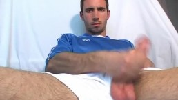Football player gets wanked his huge cock !