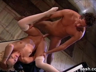 Couple making love on the piano