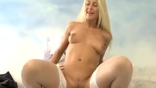 Sexy blonde in white stocking riding reverse cowgirl