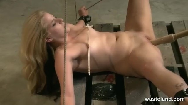 Bald cunt finger thumbs Blonde womens legs are spread wide by rope showing her bald cunt