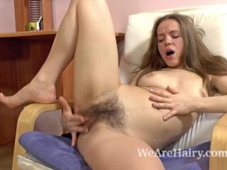 Hairy girl Gretta enjoys being cute and feminine