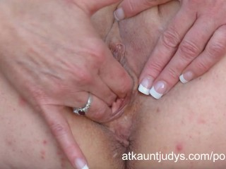 Cristine Ruby fingers her pussy outdoors.