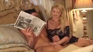 Busty blonde sucking on a big cock