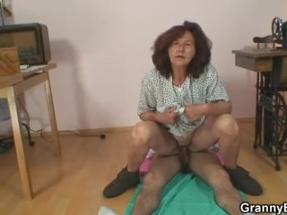 Sewing granny enjoys riding young cock 8