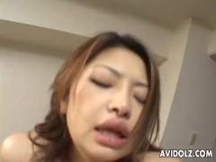 Naughty Asian babe blows and fucks hard