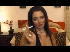Trashy girl with long nails smoking
