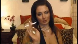Trashy girl with long nails smoking