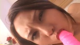 Sweet Japanese babe fucks herself with a thick dildo