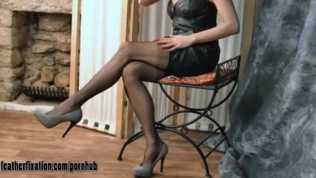 Fetish thong pic - Kinky brunette milf strips off leather dress and shows her tits and thong