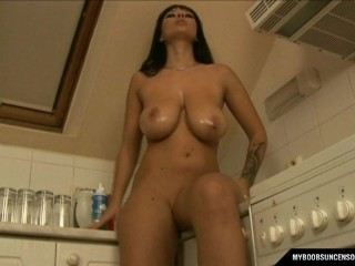 Busty babe in high heels Dominno masturbate in the kitchen with dildo