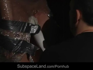 Blonde wrapped in cellophane used for kinky bdsm fantasy
