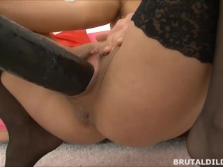 Hot babe in black stockings fucking a massive black brutal dildo in HD