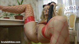 Blonde in nurse uniform shoving a long black brutal dildo in her asshole