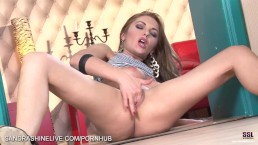 Stylish milf getting turned on in the doorway and fingers her pussy hard