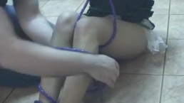 Tied up Asian lass with small boobies endures the bdsm session