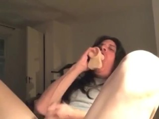 Transvestite sucks on dildo while jerking off until cums then drinks it.