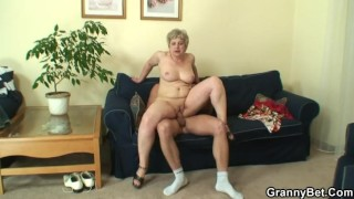 Lonely granny sucks and rides his horny cock