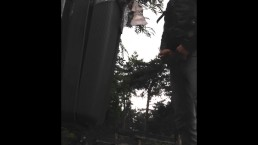 Pissing in Public against a Dustbin