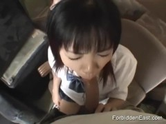 Gorgeous young Oriental student in uniform gives a long sloppy blowjob