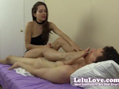 She strokes his cock while rubbing her feet and soles in his face