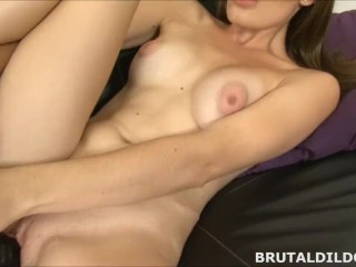 Hot babe stretching her pussy with a big black brutal dildo in HD