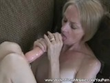 GILF inserts toy in her pussy