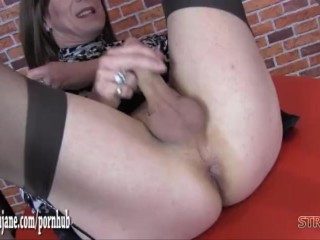 Sexy Milf dominatrix fucks masturbating TVs tight ass with big strapon cock