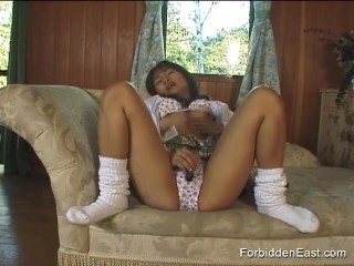 Sweet young Asian in college uniform plays with pussy through her panties