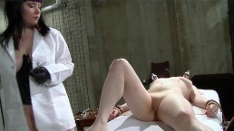 Lesbian doctor administrates an automated dildo on her hot patient