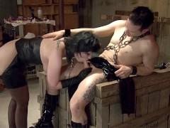 Man in bondage suit fucks brunette slut