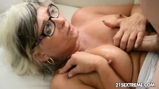 - GILF Jessye Wrestles With A Huge Cock