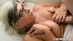 GILF Jessye wrestles with a huge cock