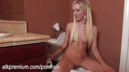 Maia Davis pees and shows you her beautiful body in a bathroom