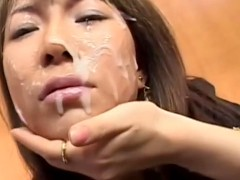 Japanese vixen has her face smudged in cum at office bukkake party