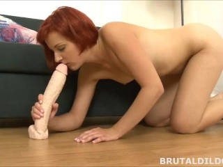Young redhead fucking her tight pussy with a big brutal dildo in HD