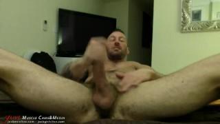 Hugh Hunter Strokes his giant cock at JockMenLive.com