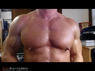 Jack Sargent plays with his beefy muscle pecs at JockMenLive.com
