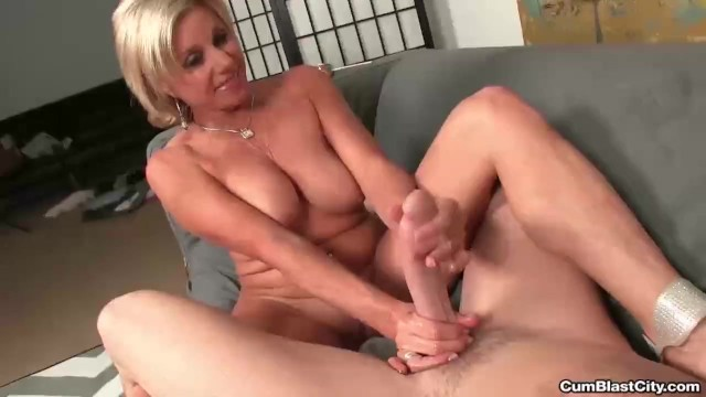 Horny milf gets splattered with hot cum