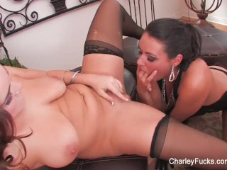 Charley and Natasha play with a double dildo
