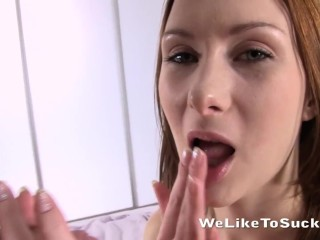 Hot redhead sucking on a mean dick