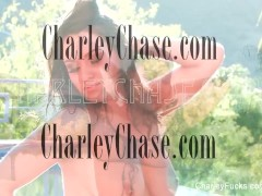 Naturally busty Charley does a quick striptease for the camera