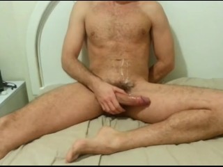hot dude jerking with porno video at home