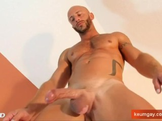 My sexy neighbour made a porn: watch his huge cock gets wanked by a guy!