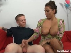 A busty milf gets cumblasted