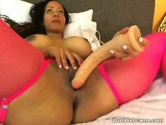 Big titted ebony toys her pussy on cam