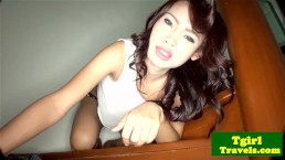 Asian ladyboy tugging her cock on the stairs
