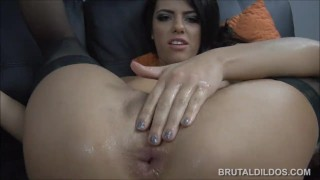 Brunette pornstar fucking both her holes with huge brutal dildos in HD porno