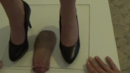 Very brutal cock crushing under plexi glass. Hard high heels stomping