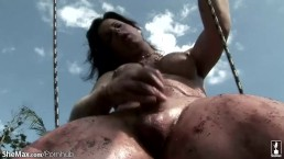 Brunette sheslut is stroking her big cock in public park